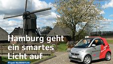 Smart vor alter Windmühle